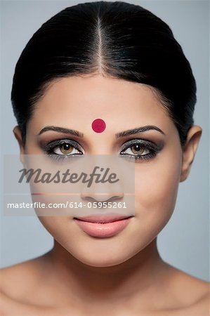 Portrait of a beautiful woman with a bindi Stock Photo - Premium Royalty-Free, Image code: 614-05955261