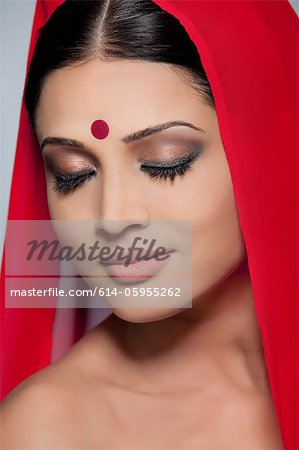 Portrait of a beautiful woman with a bindi Stock Photo - Premium Royalty-Free, Image code: 614-05955262