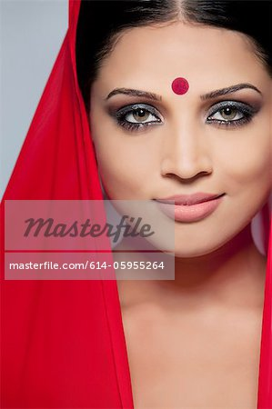 Portrait of a beautiful woman with a bindi Stock Photo - Premium Royalty-Free, Image code: 614-05955264