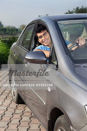 Portrait of a man in his car Stock Photo - Premium Royalty-Free, Image code: 614-05955268
