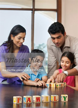 Family playing with building blocks Stock Photo - Premium Royalty-Free, Image code: 614-05955296