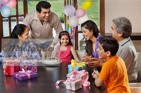 Young girl celebrating her birthday Stock Photo - Premium Royalty-Free, Image code: 614-05955299