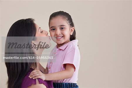 Mother kissing her daughter Stock Photo - Premium Royalty-Free, Image code: 614-05955363