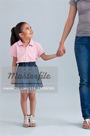 Young girl holding her mothers hand Stock Photo - Premium Royalty-Free, Image code: 614-05955365