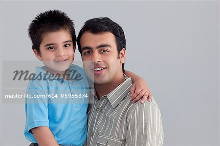 Portrait of father and son Stock Photo - Premium Royalty-Free, Image code: 614-05955374
