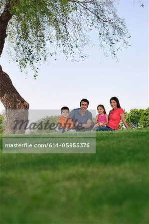 Portrait of a family in a park Stock Photo - Premium Royalty-Free, Image code: 614-05955376