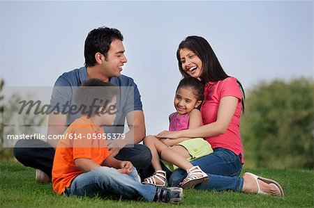 Family having fun in a park Stock Photo - Premium Royalty-Free, Image code: 614-05955379