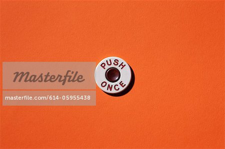 Push once button on orange background Stock Photo - Premium Royalty-Free, Image code: 614-05955438