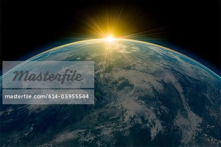 Sunrise over planet earth Stock Photo - Premium Royalty-Free, Image code: 614-05955544