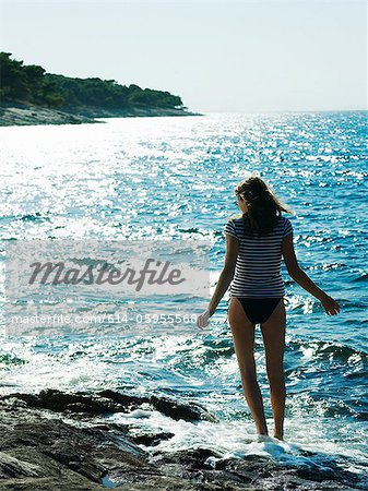 Young woman walking in sea, Dubrovnik, Croatia Stock Photo - Premium Royalty-Free, Image code: 614-05955568