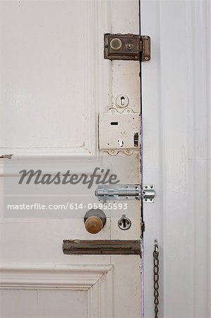 Door with many locks and bolts Stock Photo - Premium Royalty-Free, Image code: 614-05955593