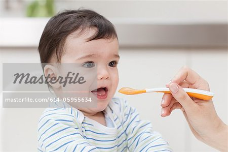 Baby boy being fed Stock Photo - Premium Royalty-Free, Image code: 614-05955634