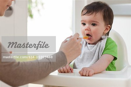 Mother feeding baby son Stock Photo - Premium Royalty-Free, Image code: 614-05955648