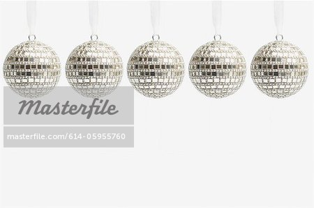 Five disco ball christmas baubles Stock Photo - Premium Royalty-Free, Image code: 614-05955760