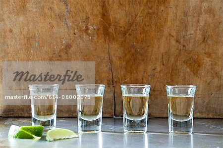 Row of tequila shots Stock Photo - Premium Royalty-Free, Image code: 614-06002075