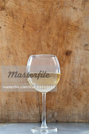 Glass of white wine Stock Photo - Premium Royalty-Free, Image code: 614-06002092