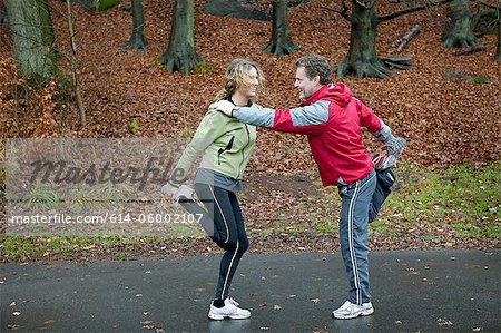 Mature couple leaning together to perform warming up exercises Stock Photo - Premium Royalty-Free, Image code: 614-06002107