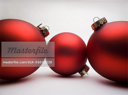 Red Christmas decorations, studio shot Stock Photo - Premium Royalty-Free, Image code: 614-06002238