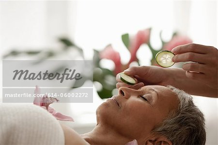 Senior woman relaxing on massage table Stock Photo - Premium Royalty-Free, Image code: 614-06002272