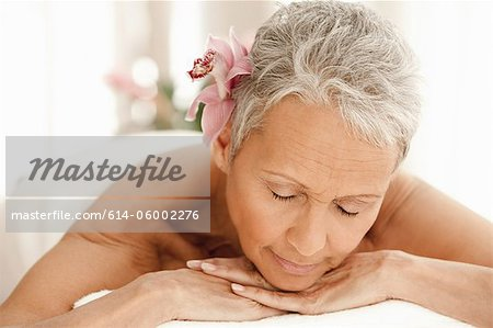 Senior woman relaxing on massage table Stock Photo - Premium Royalty-Free, Image code: 614-06002276