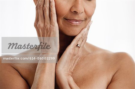 Senior woman against white background Stock Photo - Premium Royalty-Free, Image code: 614-06002299