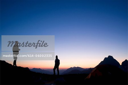 Male backpackers at camp in evening, Kool Aid Lake, Ptarmigan Traverse, North Cascades, Washington, USA Stock Photo - Premium Royalty-Free, Image code: 614-06002335