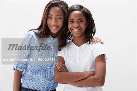 Portrait of African American sisters, studio shot Stock Photo - Premium Royalty-Free, Image code: 614-06002418