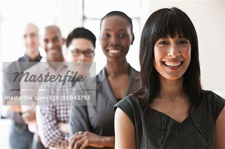 Portrait of businesspeople in a line Stock Photo - Premium Royalty-Free, Image code: 614-06043793