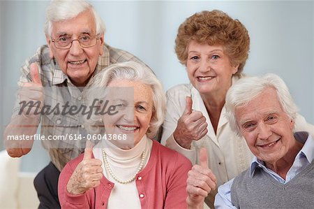 Four seniors with thumbs up, portrait Stock Photo - Premium Royalty-Free, Image code: 614-06043868