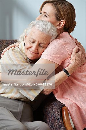Daughter and senior mother embracing Stock Photo - Premium Royalty-Free, Image code: 614-06043876