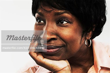 Mature woman looking away Stock Photo - Premium Royalty-Free, Image code: 614-06043899