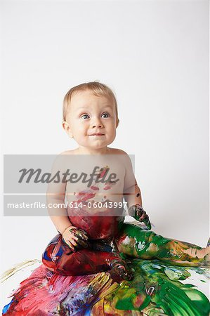 Baby covered in messy paint Stock Photo - Premium Royalty-Free, Image code: 614-06043997