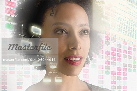 Woman surrounded by with holographic information Stock Photo - Premium Royalty-Free, Image code: 614-06044014