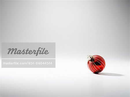 Bauble, studio shot Stock Photo - Premium Royalty-Free, Image code: 614-06044144