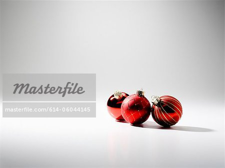 Three baubles, studio shot Stock Photo - Premium Royalty-Free, Image code: 614-06044145