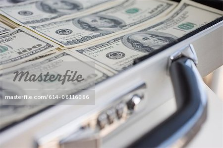 Briefcase with 100 dollar banknotes Stock Photo - Premium Royalty-Free, Image code: 614-06116066