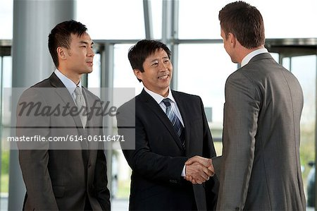 Multiracial businessmen shaking hands Stock Photo - Premium Royalty-Free, Image code: 614-06116471