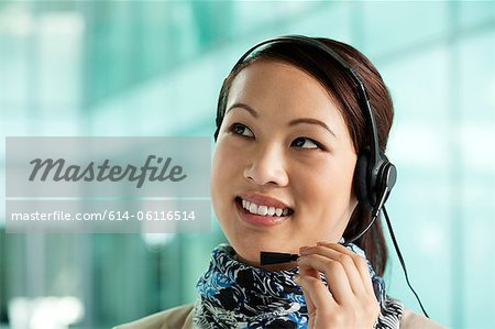 Office worker wearing headset Stock Photo - Premium Royalty-Free, Image code: 614-06116514