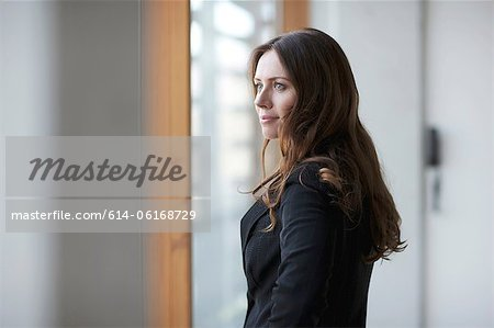 Businesswoman looking away, portrait
