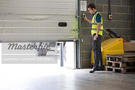 Man opening warehouse doors Stock Photo - Premium Royalty-Free, Image code: 614-06168825