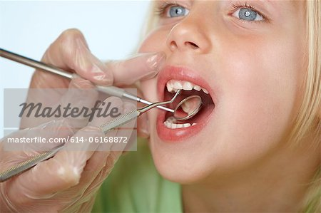 Girl having dental check up Stock Photo - Premium Royalty-Free, Image code: 614-06168872