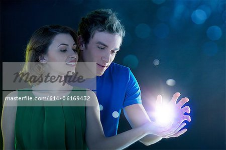 Young couple holding light Stock Photo - Premium Royalty-Free, Image code: 614-06169432