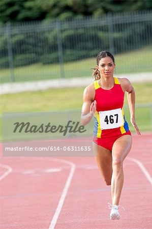 Female athlete running on track Stock Photo - Premium Royalty-Free, Image code: 614-06311635
