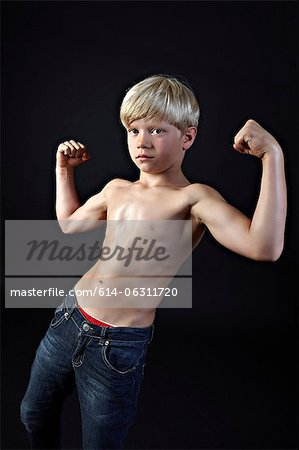 Boy flexing muscles Stock Photo - Premium Royalty-Free, Image code: 614-06311720