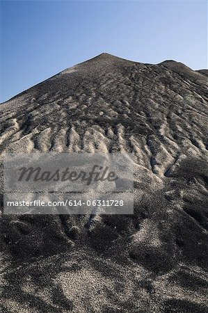 Mound of sand mixed with earth after heavy rain in commercial sand pit Stock Photo - Premium Royalty-Free, Image code: 614-06311728
