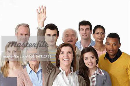 Group of people, woman with arm raised Stock Photo - Premium Royalty-Free, Image code: 614-06311765