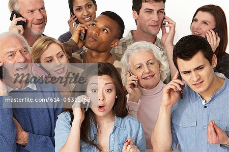 Group of people on cell phones Stock Photo - Premium Royalty-Free, Image code: 614-06311768