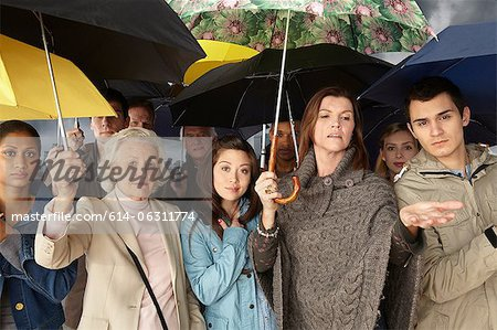 Group of people with umbrellas Stock Photo - Premium Royalty-Free, Image code: 614-06311774