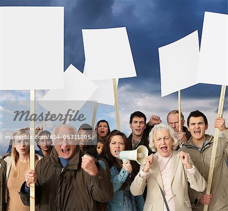Group of angry protesters holding blank banners Stock Photo - Premium Royalty-Free, Image code: 614-06311805