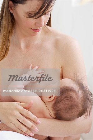 Mother breastfeeding baby Stock Photo - Premium Royalty-Free, Image code: 614-06311996